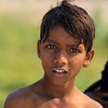 THAR DESERT. BETWEEN BIKANER AND JAISALMER. RAJASTHAN. A PORTRAIT OF A LITTLE INDIAN BOY.