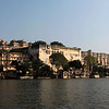 CITY PALACE SEEN FROM LAKE PICHOLA. UDAIPUR. RAJASTHAN. INDIA.