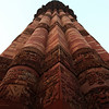 DELHI. QUTUB MINAR. CLOSE UP OF THE MINARET.