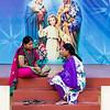 PONDICHERRY. PUDUCHERRY. INDIAN WOMEN INSIDE THE IMMACULATE CONCEPTION CHURCH. TAMIL NADU.