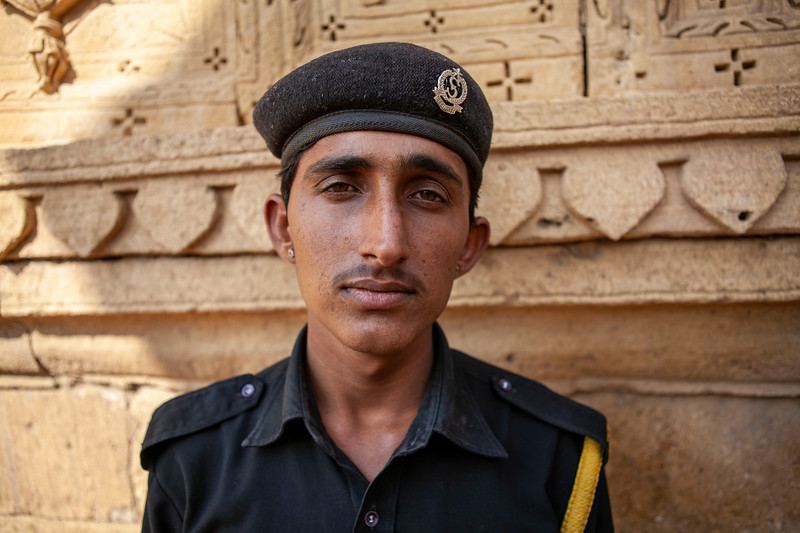 Guard of the cenotaphs, tombs of the rulers of Jaisalmer, Rajastan, India