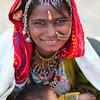 JAISALMER. RAJASTHAN. INDIAN GIRL WITH BABY.