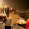 VARANASI. BENARES. MAA GANGA AARTI. JEALOUS FLOWER SELLERS AT THE GANGES RIVER. UTTAR PRADESH. INDIA.