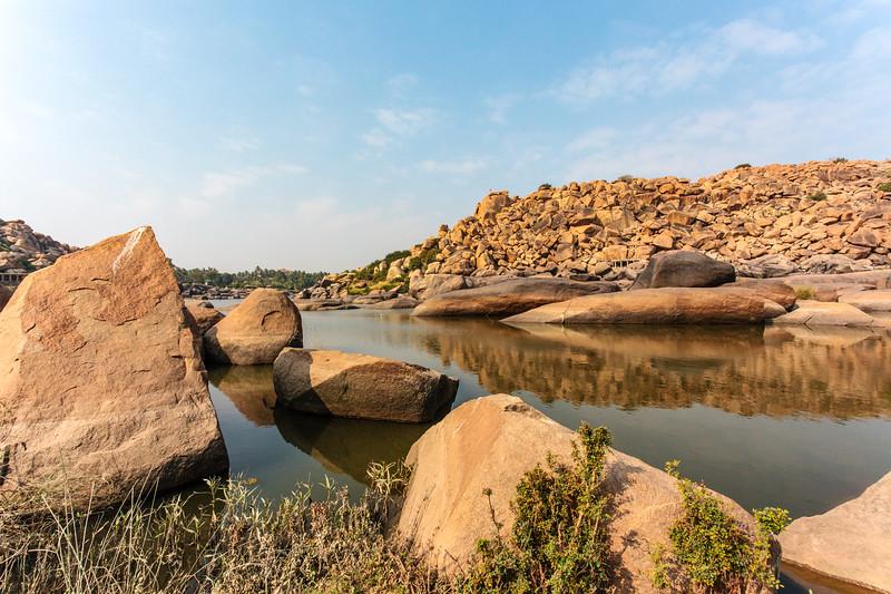 Big boulders and rocks along the Chakrairtha Lake in Hampi, Karnataka, South India - Asia