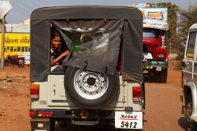 RAJASTHAN. INDIAN GIRL IN A 4-WHEEL DRIVE.