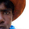 JAISALMER. RAJASTHAN. PORTRAIT OF AN INDIAN BOY WITH AN ORANGE HAT.