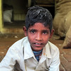 JODHPUR. RAJASTHAN. LITTLE INDIAN BOY. IN HIS SHOP.