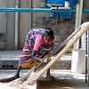 PONDICHERRY. TAMIL NADU. A WOMAN WORKING ON THE STREET.