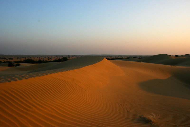 SUNSET AT THE THAR DESERT. KHARI. RAJASTHAN. INDIA.