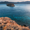 Wind and Water, Komodo Island - Indonesia<br /> <br /> This image was taken in the evening from the grassy island summit of Gili Lawa Darat. Our group of divers, and our Indonesian and British guides, sat here in the grass, almost in silence, as the sun slipped in to the ocean. Listening to the heartbeat of the ocean and the wind rushing through the dry grass, watching the freckled cobalt sea become a sheet of ink black, and being with life-long friends - this is what makes an adventure.