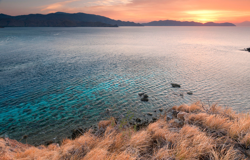 Sunset and Reef, Komodo Island - Indonesia<br /> <br /> Sunset from the rocky top of Gili Lawa Darat.  Beyond is just a handful of the 17,000 islands that make up the country of Indonesia.
