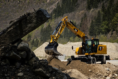 Cat M320F sifting the rocks from the dirt in Chamonix, France