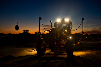 Cat motor grader at dawn in Florida