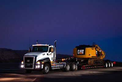 Cat 320E HEX on XL Trailer pulled by a Cat CT660