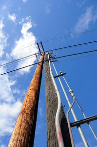 Electrical Power Pole against Blue Sky