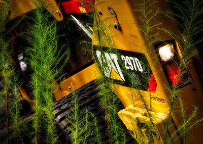 Cat 292D2 Skid Steer in tall weeds