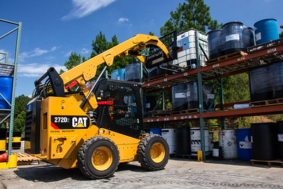 Cat 272D2 Skid Steer loading shelves in North Carolina