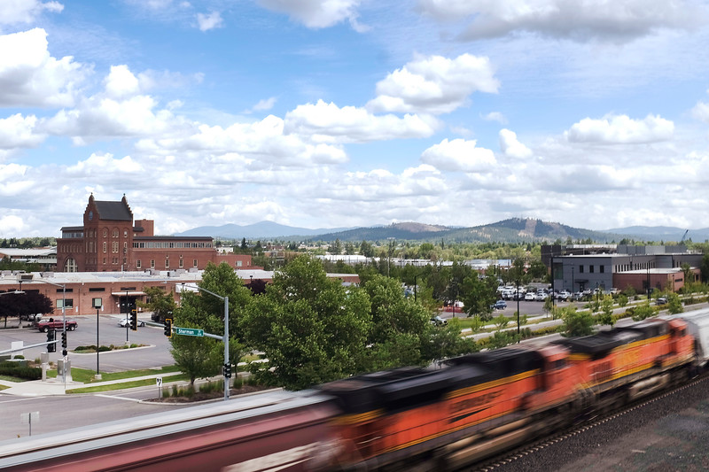 In this slow shutter speed photograph, a train passes through the University District as seen University District Gateway Bridge in Spokane, Wash., Monday, June 7, 2021. (Young Kwak)