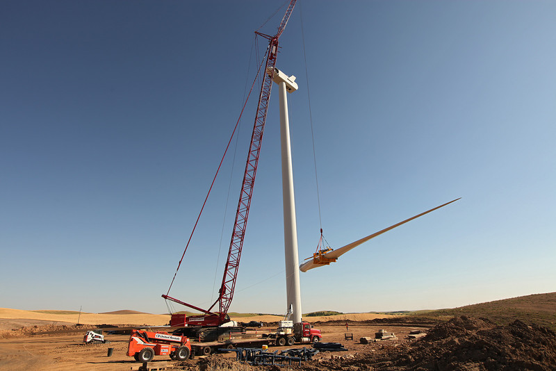 The installation of a blade to a turbine at the Palouse Wind Project, near Oakesdale, Wash., is photographed on Thursday, August 16, 2012. (Young Kwak/The Pacific Northwest Inlander)