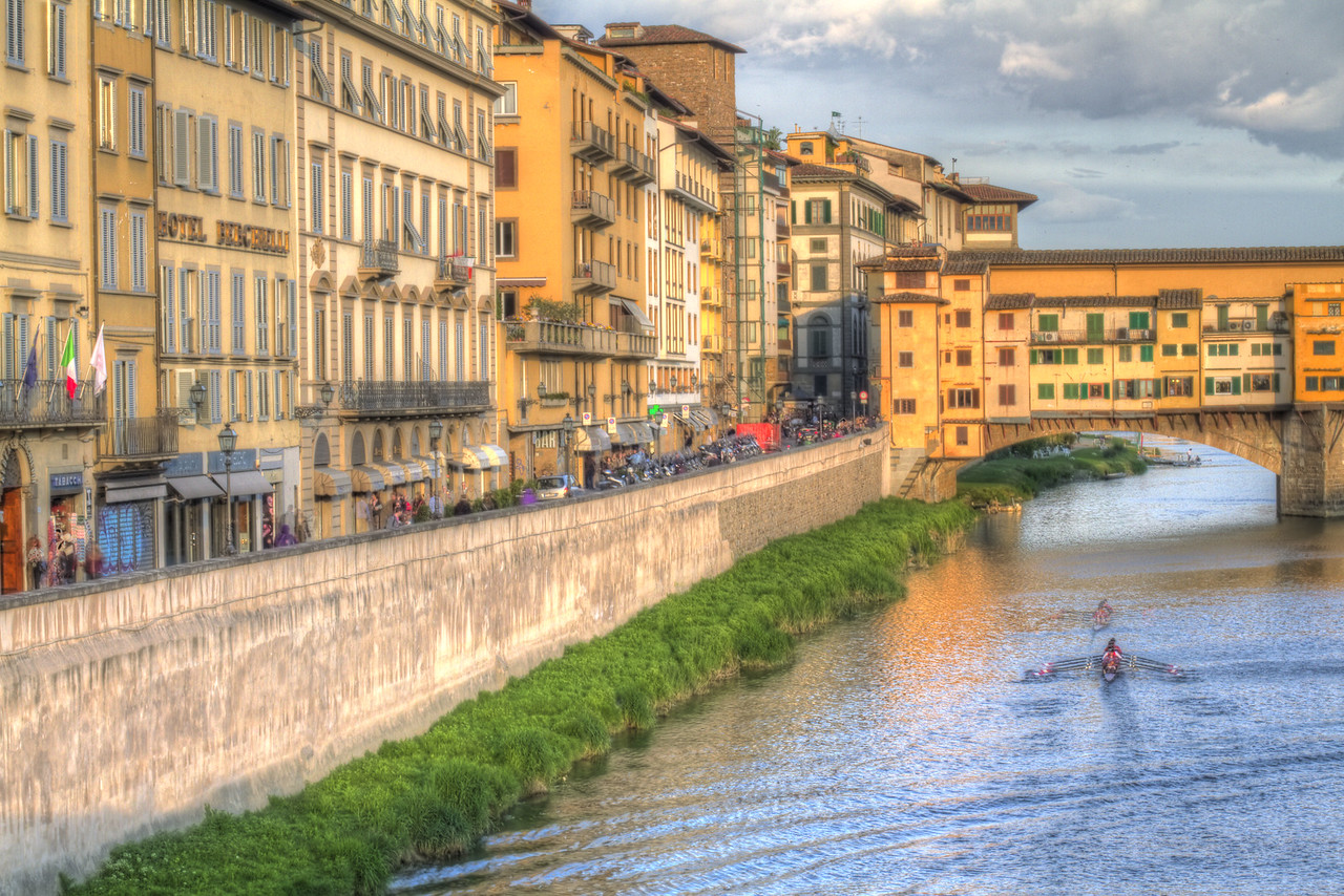 Canoes on the Arno River under the Ponte Verde Bridge