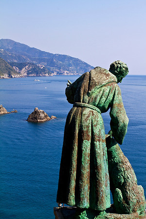 Saint Francis and the wolf over looking the Harbour in Monterosso, Cinque Terre, Italy