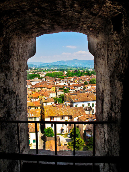 Beautiful Lucca seen thru an opening in the  Tower Guinigi