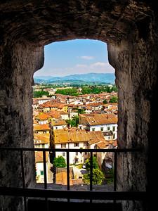 Beautiful Lucca seen thru an opening in the  Tower Guinigi