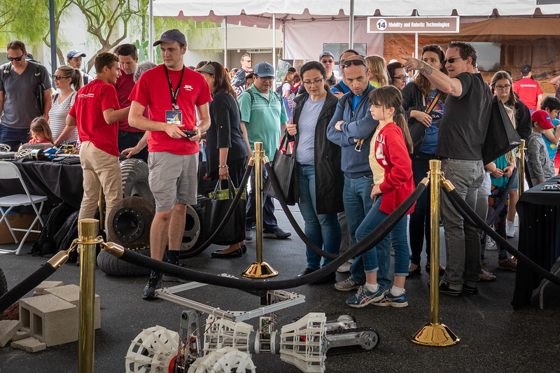 The robot tent draws a crowd of onlookers