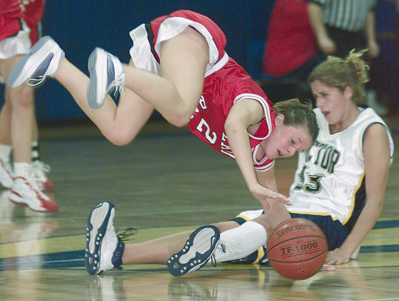 JH Vic/PM 2 - Megan LeMoyne of Pal-Mac goes airbourne after a battle for the ball with Victor's Courtney McVicker in the first half.