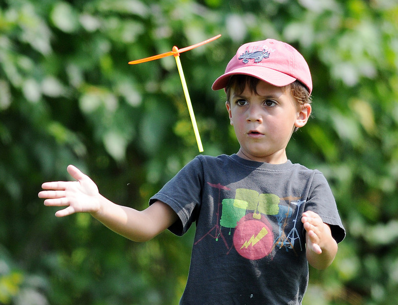 JACK HALEY/MESSENGER POST<br /> Travis Peters 4, of Ontario plays with a Spinner while attending The 9th Annual Northeast Model Helicopter Jamboree on Friday at the Rochester Aero Modeling Society's (RAMS) flying field in Macedon.