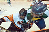 Anthony Bertolani (left) and Notre Dame's Colin Hilt battle for the puck along the boards in the third period.