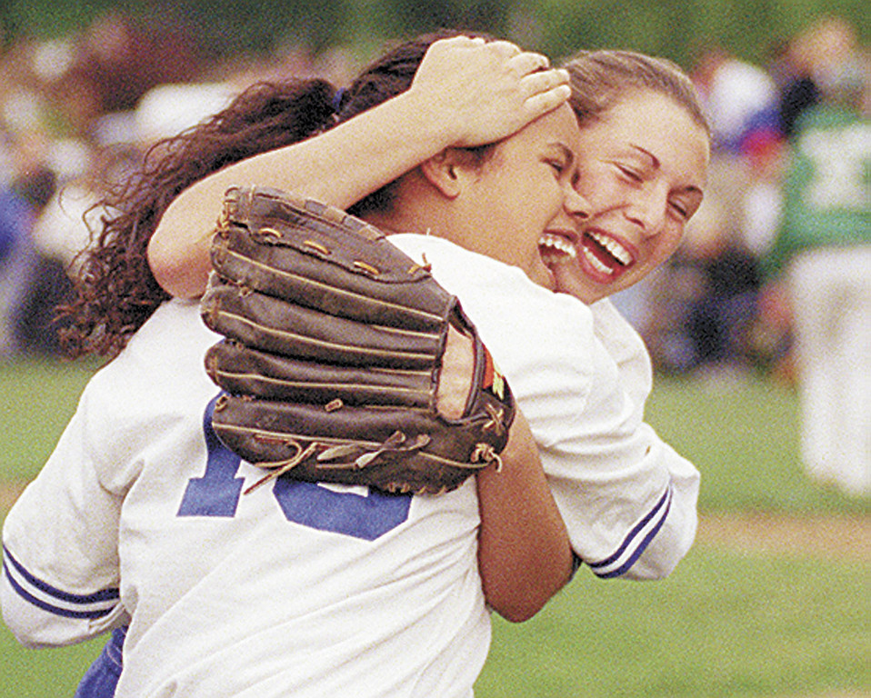 JH Celebration - Honeoye softball players Migna Gonzalez (left) and Niki Klemann celebrate their 6-3 Section Five Class C playoff win over Naples on Thursday.