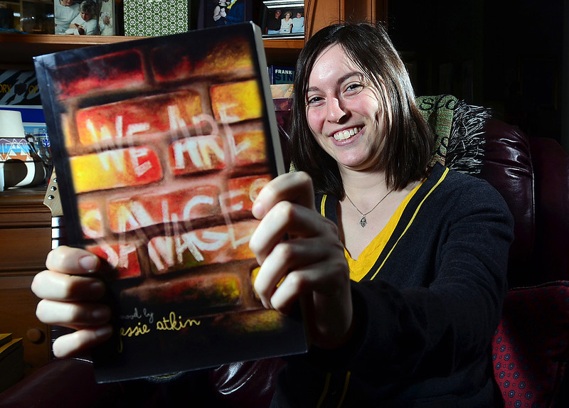 "Jack Haley/Messenger Post<br /> Author Jessie Atkin holds her book ""We Are Savages"" inside her Brighton home."