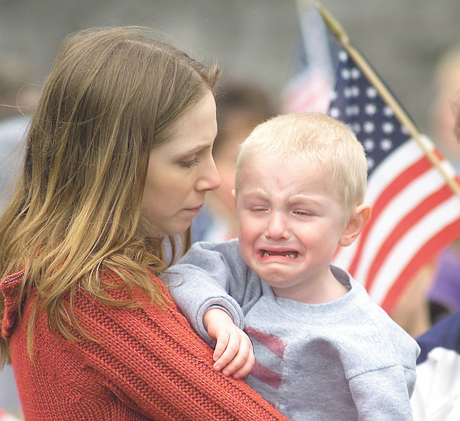 """jhreservists1 - Melissa King of Greece holds her two and a half year old son Austin King who is crying for his """"Daddy""""  Brian Incardone, who is a member of the 479th Engineer Battalion that left Canandaigua on Friday for Fort Drum."""