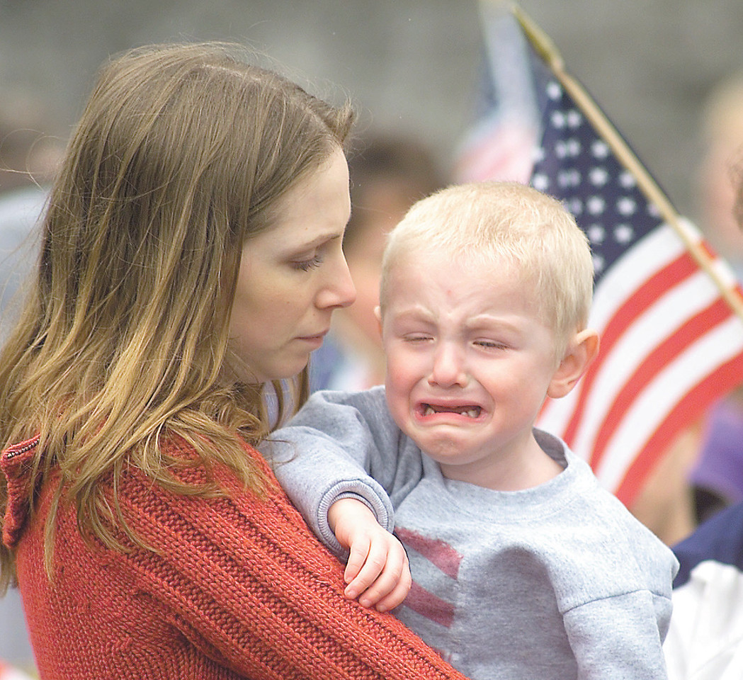 "jhreservists1 - Melissa King of Greece holds her two and a half year old son Austin King who is crying for his ""Daddy""  Brian Incardone, who is a member of the 479th Engineer Battalion that left Canandaigua on Friday for Fort Drum."