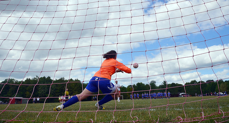 Bloomfield keeper MacKenzie Henderson tries to make a save in the shootout.