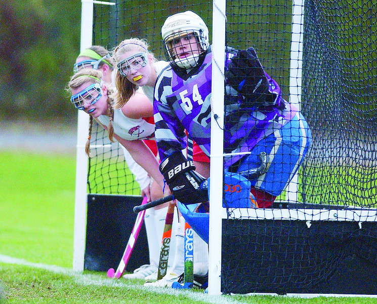 JACK HALEY/MESSENGER POST<br /> Members of the Fairport defense wait in the goal with goal keeper Taryn Treviso during their victory over Hilton on Thursday, October 21.