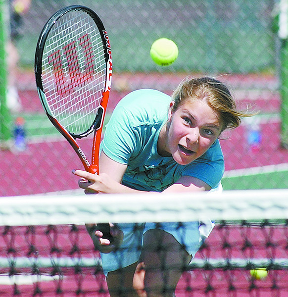 tennisJH6 - Sarah Kenton of Canandaigua hustles to get to a shot during her match with her partner and sister Hailey Kenton as they took on Ashley O'Dell and Bethany Beuchat.