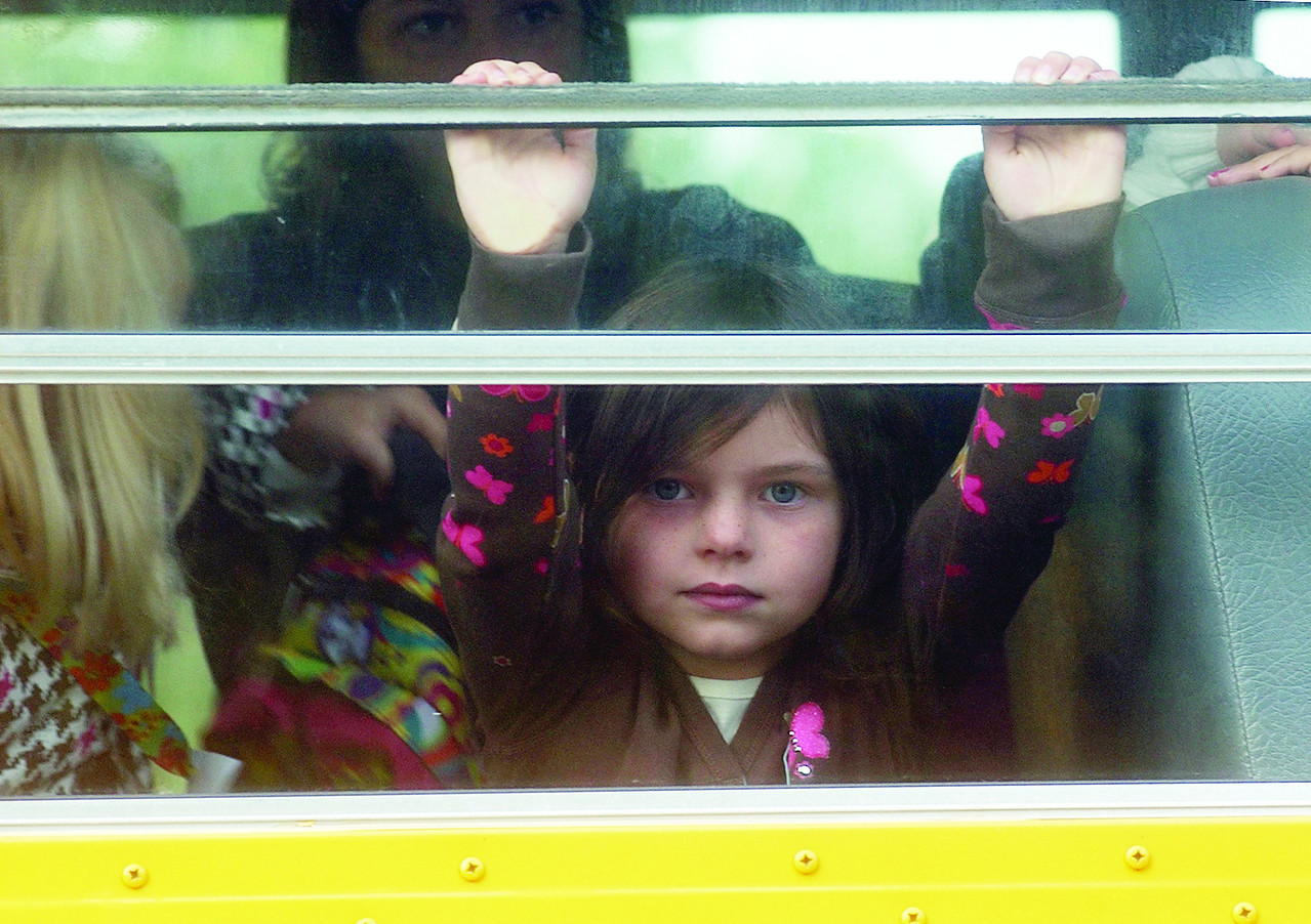 Jack Haley/Messenger Post<br /> Alana Welch looks out the school bus window for her first day of kindergarten at Canandaigua on Friday, September 11.