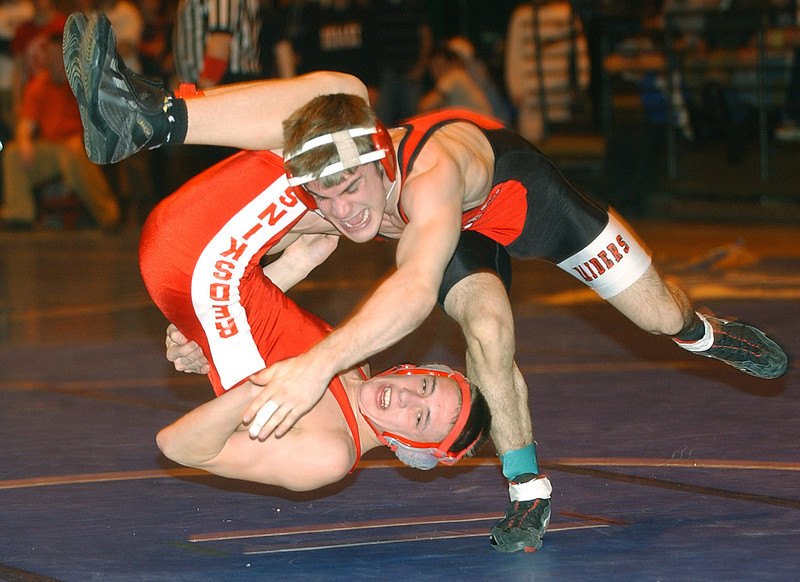 Josh Rudy of Palmyra-Macedon takes down Canisteo's Kyle Amidon during their Division 2 semifinal match at 125 pound for the Section Five State qualifier. Rudy won the match 8-4.