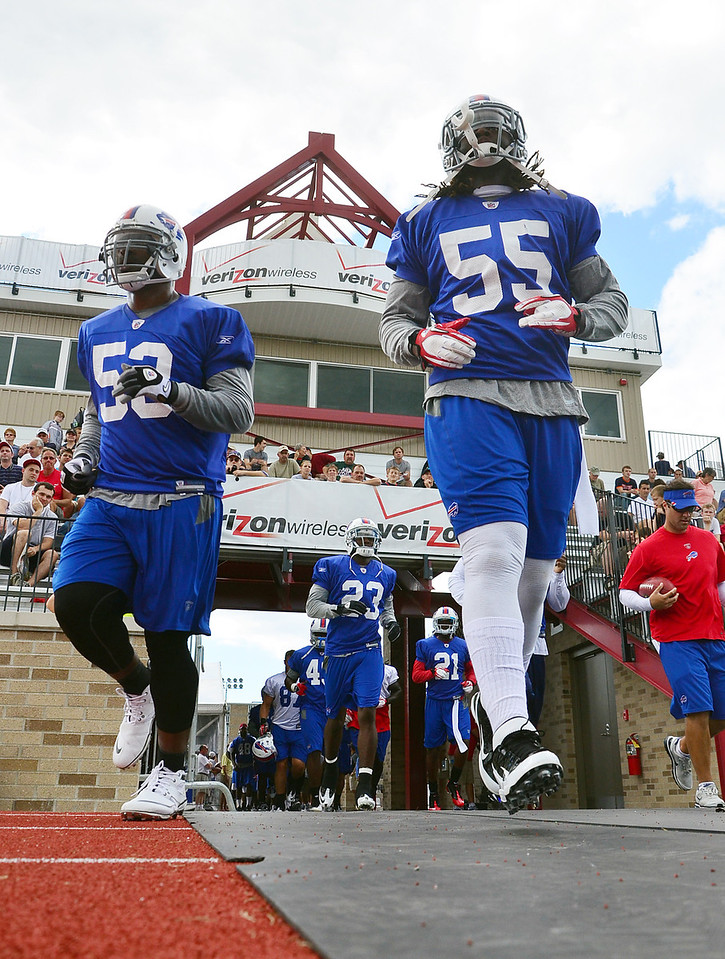 JACK HALEY/MESSENGER POST<br /> Members of the Buffalo Bills file into the new grass stadium on the campus of St. John Fisher College.