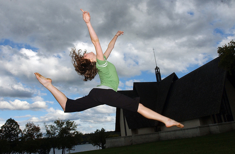 JACK HALEY/MESSENGER POST<br /> Elizabeth Vinette, a member of the Keuka College Dance Team does a leap in the lawn near Norton Chapel during a rehearsal session.