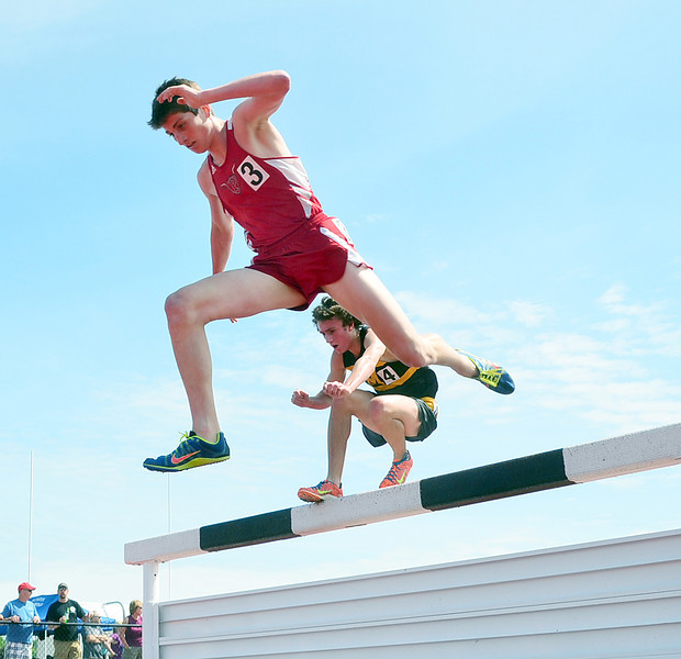 JACK HALEY/MESSENGER POST<br /> Mitch Moran of Penfield leads A.J. Stuver of McQuaid during the running of the Class AA 3,000 steeplechase.