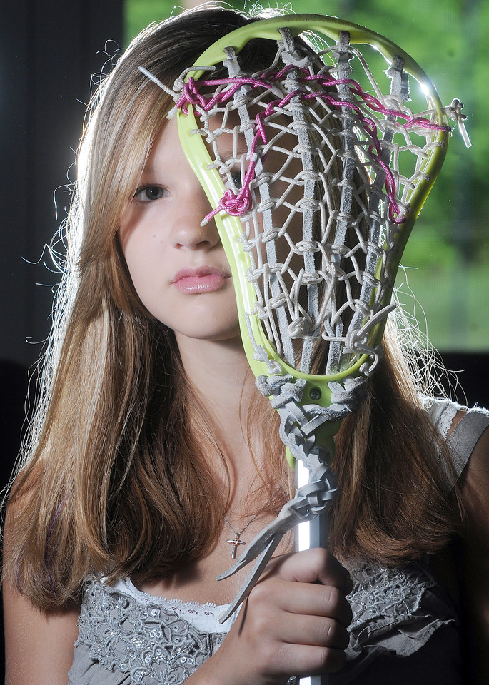 Jack Haley/Messenger Post<br /> Victor eighth grader Allie Kem suffered a concussion while playing lacrosse and was selected by the Brain Injury Association  of New York State to share her story for their REAP Project.
