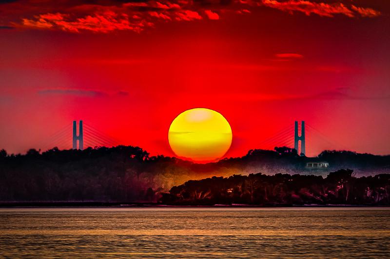 Super Sun Cradled on Bridge