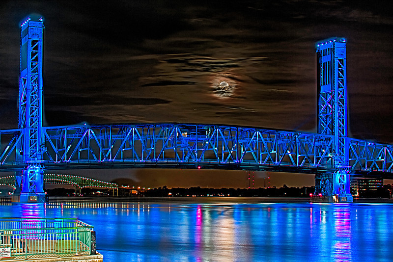 Supermoon Rise 06232013 Downtown Jacksonville Florida Downtown Main Street Bridge. There was a photographer at the rail in the foreground used Lightroom to get rid of my only mistake was not knowing how to adjust shutter settings to get a clear surface shot of the moon, This is a HDR 3 shot +/- 2 in AV mode at AV value 5.6 at 55mm. Another night of learning. Lightroom 5 with HDR Efex Pro 2,Dfine 2, Viveza 2.
