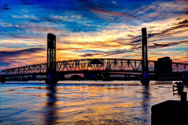 Main Street Bridge and Acosta Bridge at sunset. AV 25 AEB +/- 2. HDR Photomatix Fused. I used a phone app TPE to find the spot with the correct Azimuth for this view and used Google maps building view to check multiple places and views, arrived 15 minutes before the sunset time stated in the app got set up and got this first of many photos along with monitoring the cloud cover during the day on a weather app satellite view. From what I saw driving there noway I could foresee these photos.
