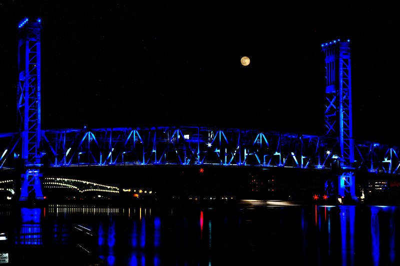 Full Moon, Supermoon, over Main Street Bridge Jacksonville Florida 06232013. Used the Promote Control 9 shots at .7 ev and Photomatix. It took 8 minutes and the moon moved about 4 times its size.This is toned mapped my hand in Photomatix (all presets [extras also] did not work) and used the Lasso tool to select exposure to get moon surface. Canon T2i EF-S 18-55mm f/3.5-5.6 IS set at 55mm (=88mm) ISO 100 Shutter speed 3.2 (moon surface) thru 120 AV 29. This was total experiment had no idea what the outcome and was at the end of time for session, no matter what I did I could not get a shot of surface using normal +/-2 ev. Seeing the movement of moon just chuckled no way I will be able to use this but just playing in Photomatix and wow. real colors every other tone mapped photo the a lot of pink on bridge.