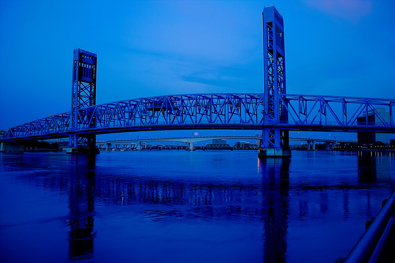June 23, 2013 at 0615 Super Moon setting at sunrise under Jacksonville Florida Main Street Bridge and above Acosta Bridge. When I arrived on location it was full and above the Main Street BUT slipped behind a cloud and while photographing some other things I looked up and there it set between the bridges.