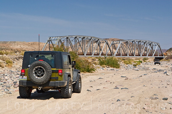 Jeeps approaching the railroad bridge in Afton Canyon, Mojave Road (Old Government Road) in the Mojave Desert